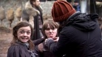 Maisie Williams (Arya Stark) and Isaac Hempstead Wright (Bran Stark) being cute.
